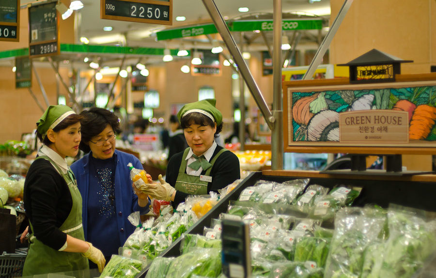 Green House Ladies help a customer at the Shinsegae Grocery Store in Seoul, South Korea (photo: Patrick Lydon)