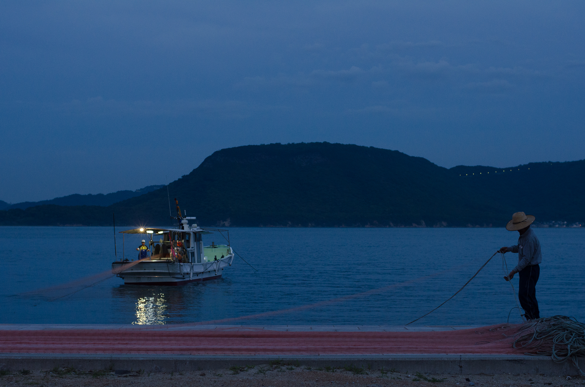 Locals installing protective netting at the beachside in Megijima, Japan (Photo: Patrick M. Lydon)
