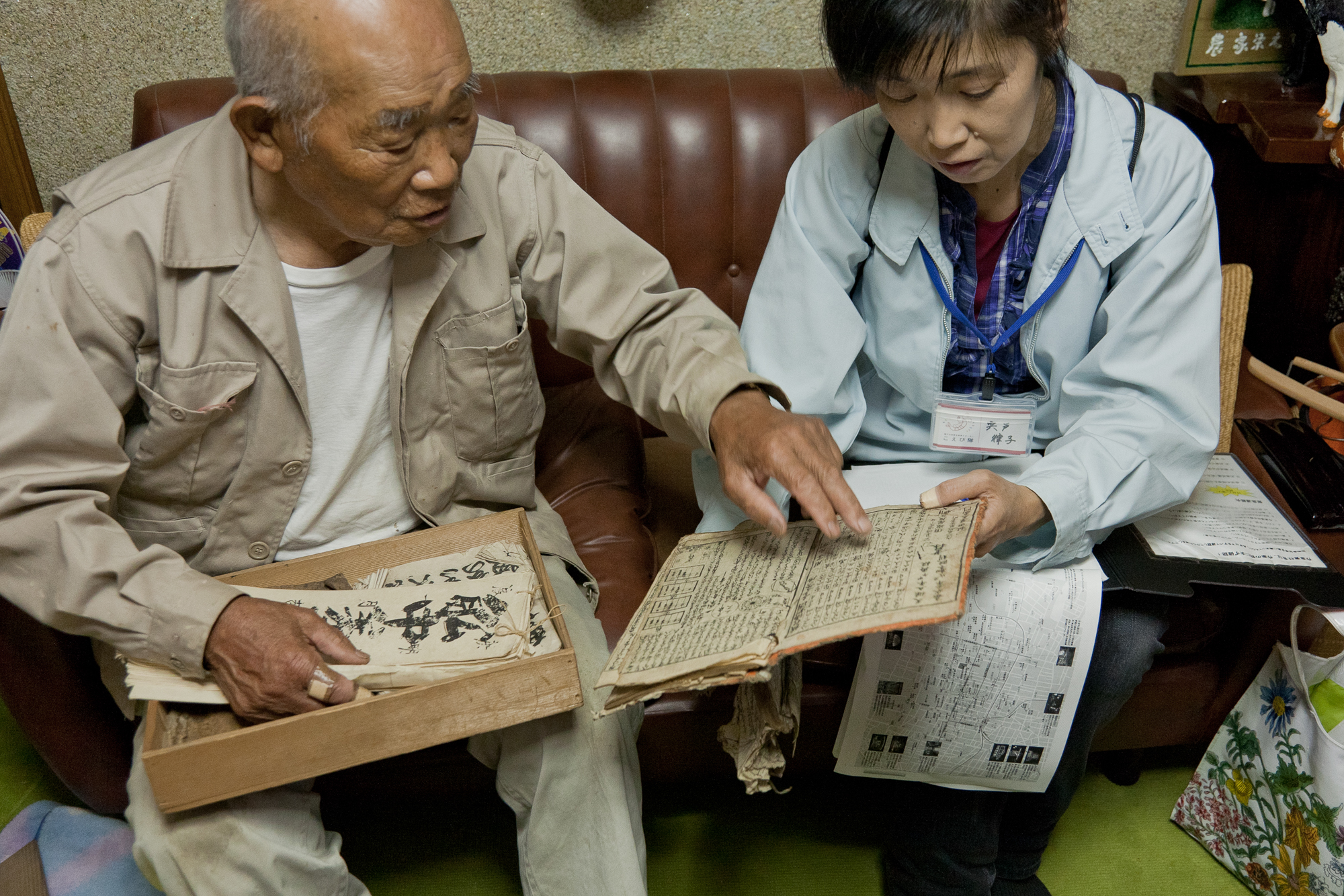 Yichi Takagishi explains his family history documents, some dating from over 200 years ago.