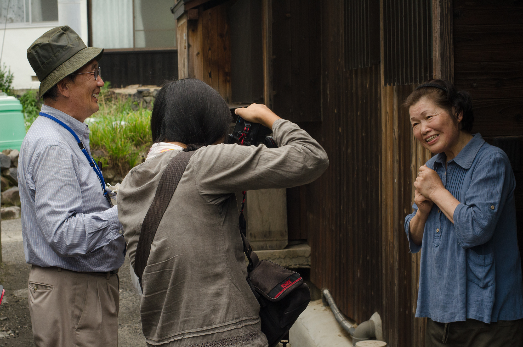 Photographer Suhee Kang taking a portrait of one of the Megijima villagers