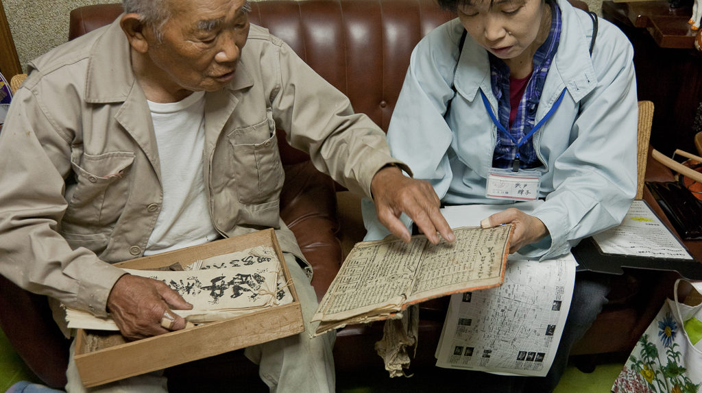 Going through family history on Megijima (photo: Suhee Kang)
