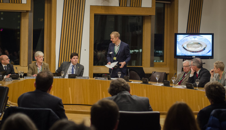 "Nick Dearden speaks before members of the Scottish Parliament at 'Natural Capital, Managing the Risks"" forum (photo: P.M. Lydon 