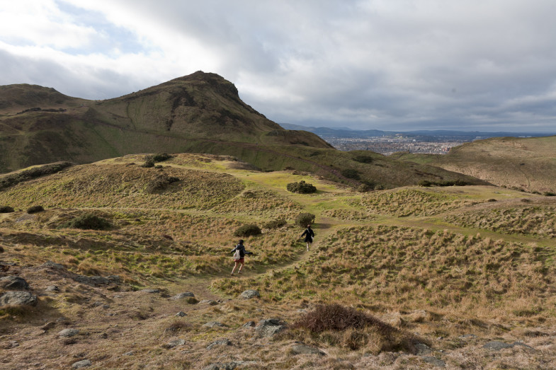Patrick and Heeyoung running through Holyrood Park, Edinburgh, Scotland (Suhee Kang | CC BY-SA)
