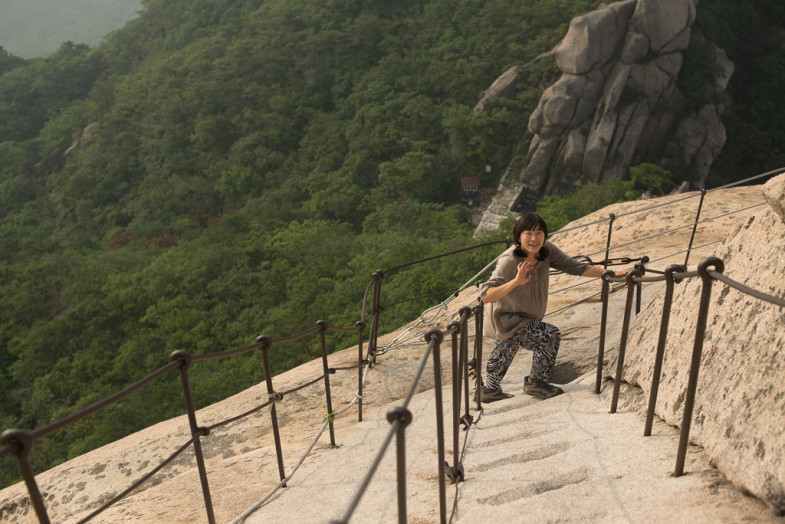Suhee walks the rather convenient stairs up Bukhansan mountain in Seoul, South Korea (CC BY-SA, P.M. Lydon)