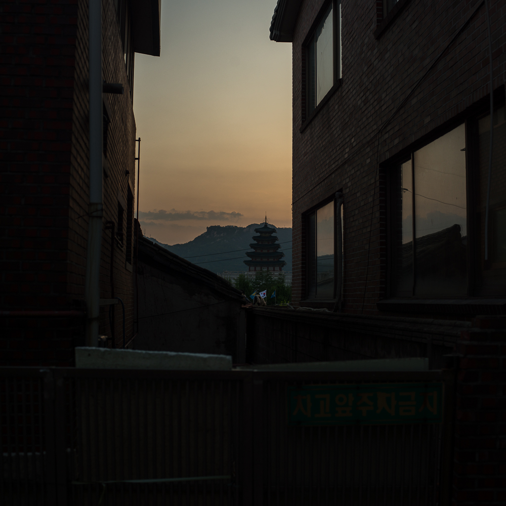 In the Samcheong Dong neighborhood at dusk with The National Folk Museum in the distance, Seoul, South Korea | photo: CC BY-SA, P.M. Lydon