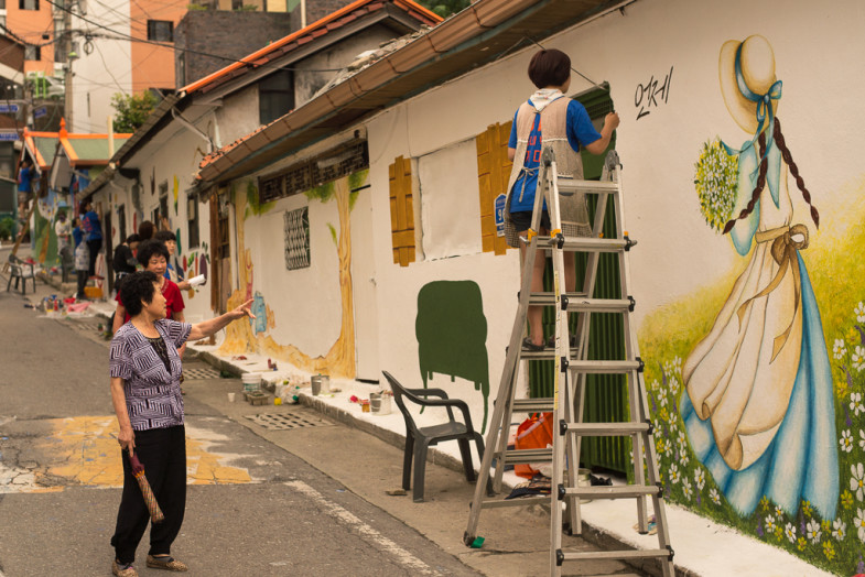 "Locals give feedback and encouragement to the street painters in the ""Daedong"" neighborhood in Daejeon, South Korea"