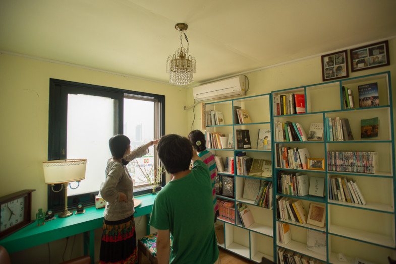 Suhee in the Small House Library with Booyoung and Enduk