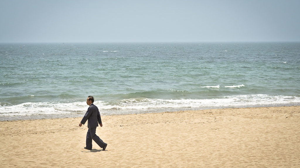 Businessman on the beach in Haeundae, South Korea (Photo: P.M. Lydon | CC BY-SA)