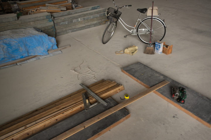 Arrived at the warehouse by bike to find and cut wood for a table at The Branch in Osaka, Japan