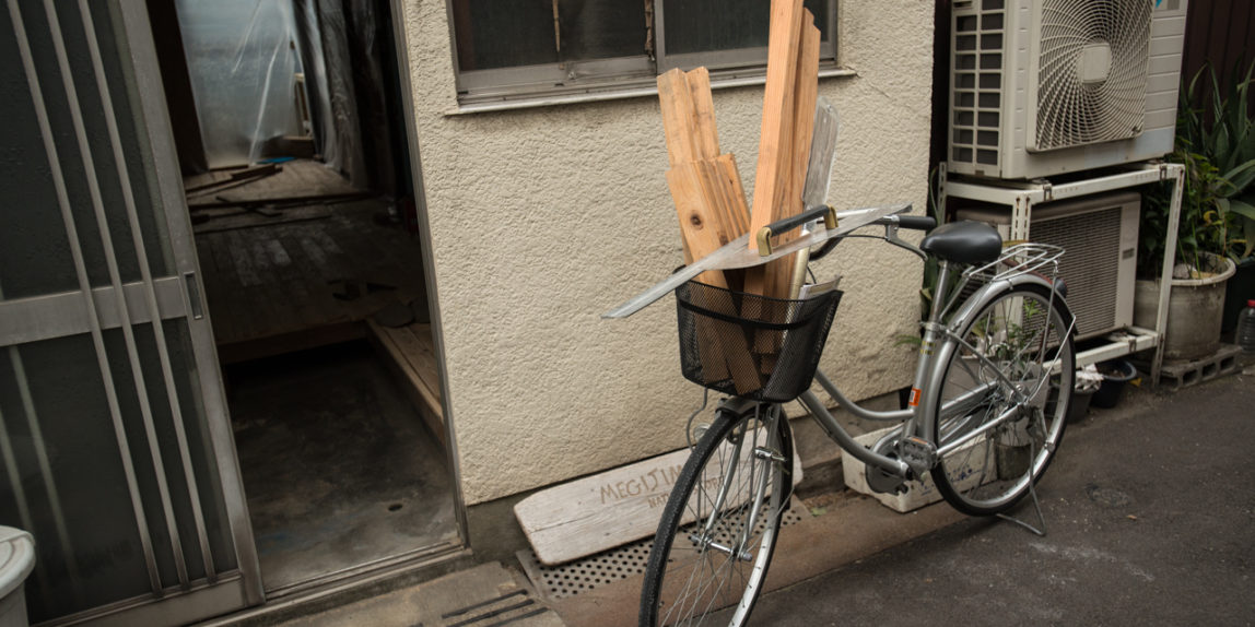 Wood transported from the warehouse by bike to build a table at The Branch in Osaka, Japan