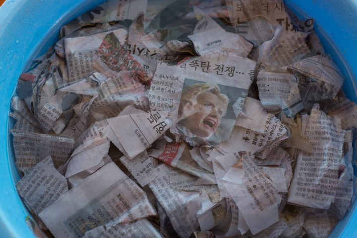 International newspapers being used for paper making during a public workshop in Megijima, Japan